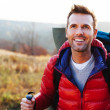 Happy young man hiking — Stock Photo