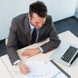 Stock Photo: Business mworking on financial data