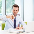 Businessman showing thumbs down — Stock Photo