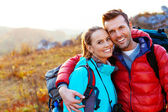 Young couple in mountains smiling — Stock Photo
