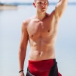 Muscular swimmer looking away — Stock Photo