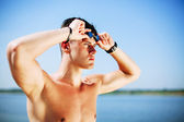 Triathlon swimmer looking away — Stock Photo