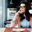 Attractive woman looking away thoughtfully — Stock Photo #39154507