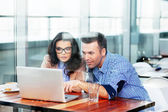 Couple of professionals debating in front of laptop — Stock Photo