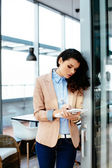 Attractive woman making notes — Stock Photo