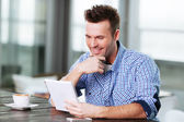 Adult putting his thoughts on paper — Stock Photo