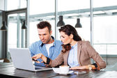 Couple in front of laptop display — Stock Photo