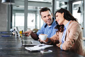 Couple having nice time in front of laptop — Stock Photo