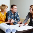 Couple with architect discuss blueprints — Stock Photo