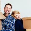 Couple with carton boxes — Stock Photo