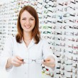 Opticipresenting eyewear frames — Stock Photo #40286045