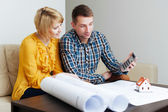 Couple alculating construction budget — Stock Photo