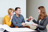 Couple receiving keys from estate agent — Stock Photo