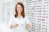 Optician presenting eyewear frames — Stock Photo