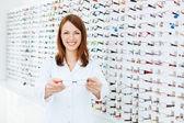 Optician presenting eyewear frames — Stock Photo