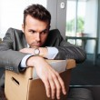 Laid off manager sitting down — Stock Photo #40596331