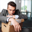 Stock Photo: Laid off manager sitting down