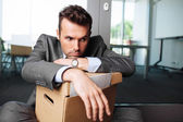 Laid off manager sitting down — Stock Photo