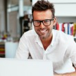 Student with geek glasses using laptop — Stock Photo #47774657