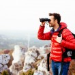 Hiker looking through binoculars — Stock Photo #47774775