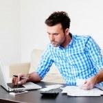 Man paying bills with laptop — Stock Photo #47778251