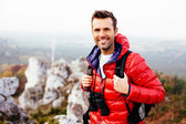 Smiling hiker on the trail — Stock Photo