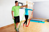 People exercising with resistance bands — Stock Photo