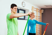 People exercising with isometric bands — Foto de Stock