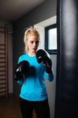 Girl during a boxing training — Photo