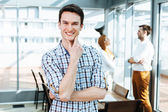 Positive young professional in office — Stock Photo