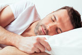 Sleeping attractive man — Stock Photo
