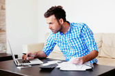 Man checking home finance — Stock Photo