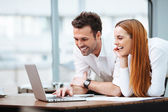 Two professionals looking at laptop — Stock Photo