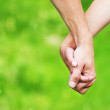 Holding hands — Stock Photo #12163738
