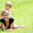Beautiful little girl with her mother on the nature — Stock Photo