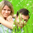 A young couple in love on the grass — Stock Photo