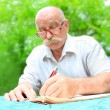 Man writes papers - Stock Photo