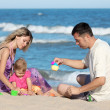 Family on the shore of the sea — Stock Photo