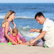 Family on the shore of the sea — Stock Photo #12164229