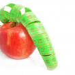 Apple with measuring tape — Stock Photo