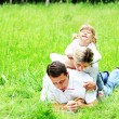 Young family in nature — Stock Photo #12164437