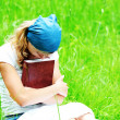 Stock Photo: Young girl reads Bible