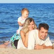 Stock Photo: Family on the shore of the sea