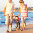 Family on shore of sea — Stock Photo #12167442