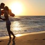 Young couple having fun on the beach — Stock Photo