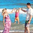 Family on the shore of the sea — Stock Photo #12167486