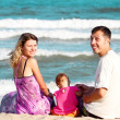 Family on the shore of the sea - Stock Photo