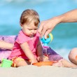 Dad with baby on the shore of the sea - Stock Photo