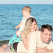 Family on the shore of the sea — Stock Photo #12167711