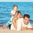 Family on the shore of the sea — Stock Photo #12167713